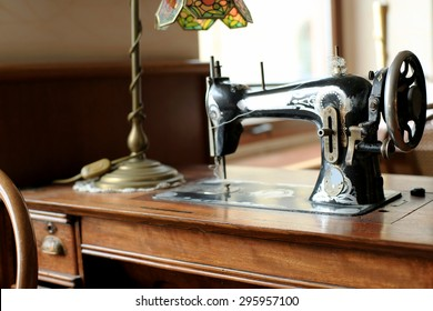 Black retro sewing machine in an old house