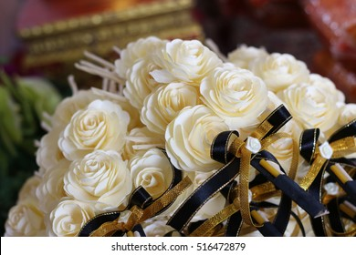 Black ribbon Flowers mourned. concept feel sad. focusing on the black ribbon