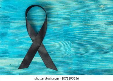 Black ribbon-symbol of fight against melanoma and skin cancer. Studio Photo