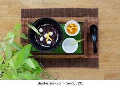 Black rice sweet pudding on wooden background