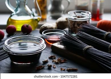 Black rice vermicelli, vinegar, olive oil and vegetables. Asian cuisine