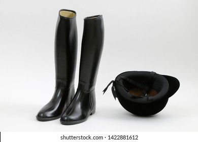 Black riding boots and helmet
