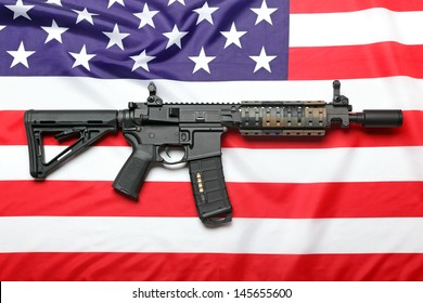 "The ""Black Rifle"" AR-15 carbine and the flag of USA"