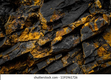 black rock background with gold  / yellow colored rocks -