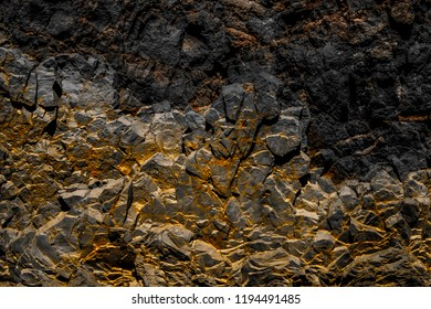 black rock background with golden / yellow color -