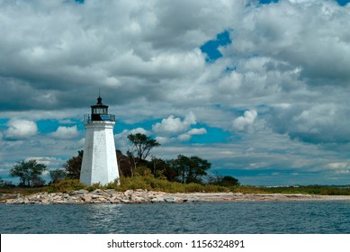 Black Rock Harbor lighthouse, also referred to as Fayerweather Island lighthouse, is illuminated by the sun though the clouds.