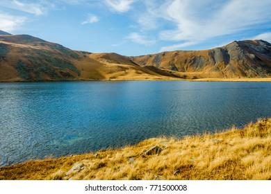 Black Rock lake in autumn colors, border lake between Georgia and Russia, Lagodekhi national park, Georgia