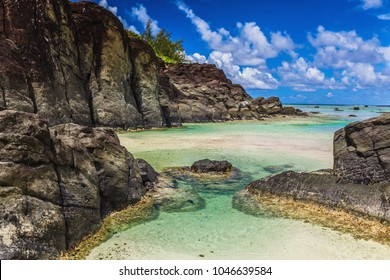 Black Rock, a tropical beach surrounded by black rocks, Rarotonga, Cook Islands