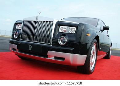 Black Rolls Royce Phantom on a red carpet