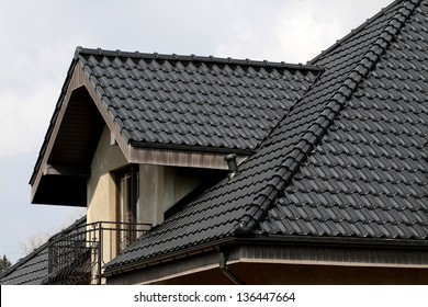 black roof against the sky