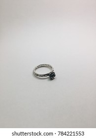 Black rose ring on a white background