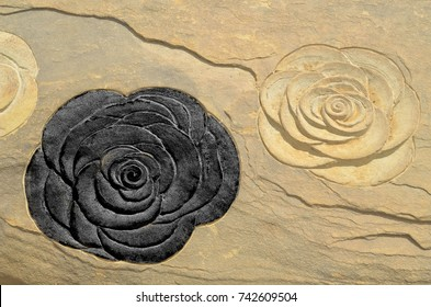 black roses carvings on stone