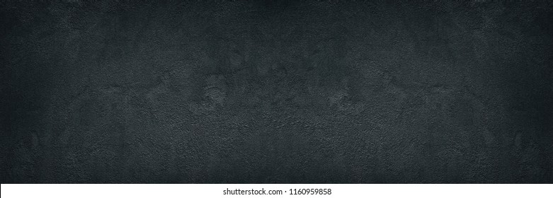 Black rough concrete wall wide texture. Fine textured cement plaster surface with small cracks. Dark gray grunge background