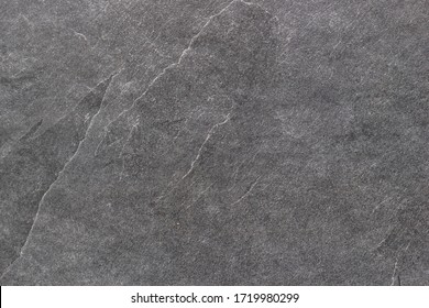 Black rough stone surface. Texture background.