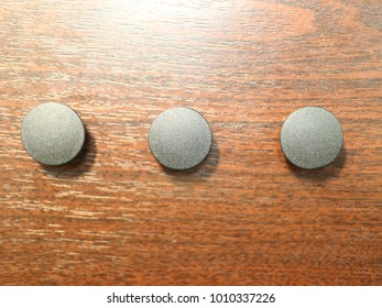 black round stubs for furniture on the office table