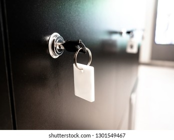 Black Row of metal lockers with locks, keys and numbered red tags in a sports changing room for securing personal effects during training, Mockup, Mock-up. A safe place to store the equipment.