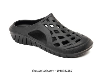Black rubber casual crocs isolated on white background