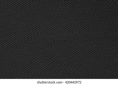 Black rubber. Hexagon shaped bumps look like cells.
