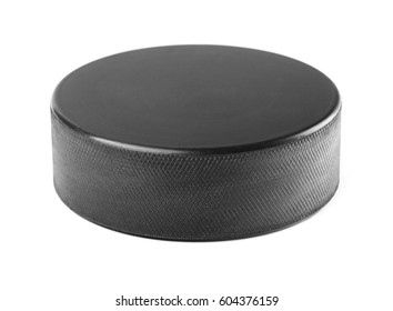Black rubber hockey puck isolated on white background