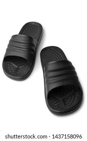 Black rubber slippers on white background