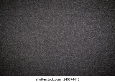 Black rubber surface background.