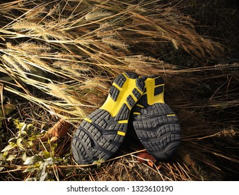 Black running shoes with yellow stripes