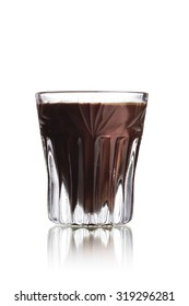 Black Russian alcoholic cocktail in faceted shot glass (shooter)