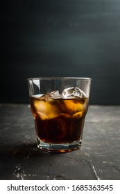 Black russian cocktail with ice and coffee liquor. Selective focus. Shallow depth of field.