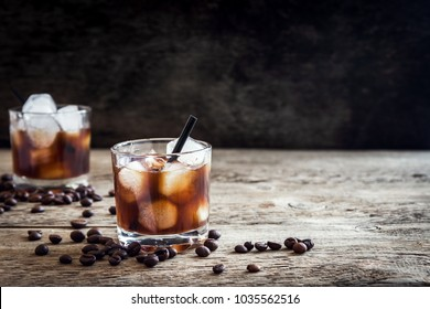 Black Russian Cocktail with Vodka and Coffee Liquor. Homemade Alcoholic Boozy Black Russian drink with coffee beans on wooden background with copy space.