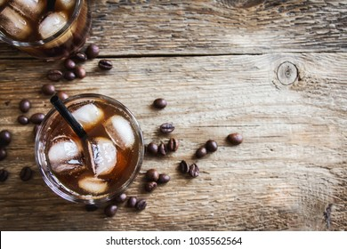 Black Russian Cocktail with Vodka and Coffee Liquor. Homemade Alcoholic Boozy Black Russian drink with coffee beans on wooden background.