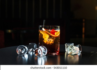 Black russian isolated on a black background cherry