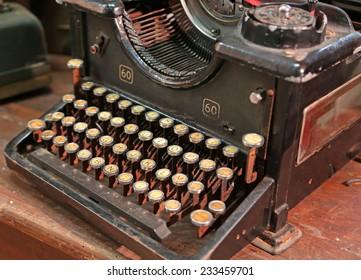 black rusty typewriter with white keys
