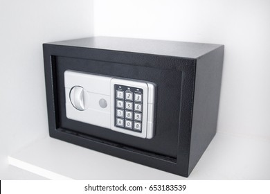 Black safe box in the shelves