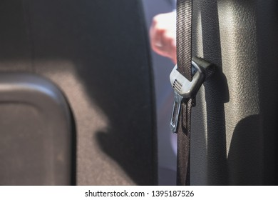 black Safety Belt in the Interior of a Car