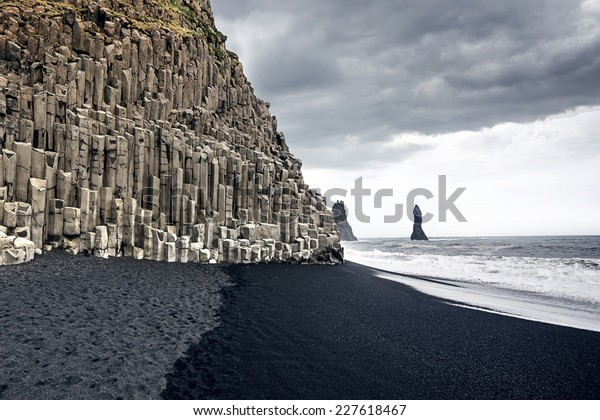 The black sand beach of Reynisfjara and the mount Reynisfjall from the Dyrholaey promontory in the southern coast of Iceland.