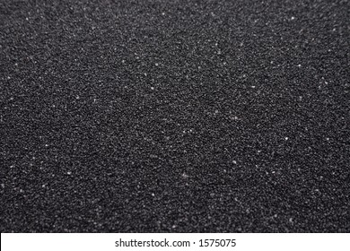Black sand closeup background