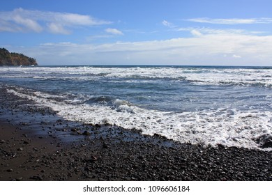 The black sand and rocky beach in Pololu Valley meeting the Pacific Ocean, Kohala Coastline, Pololu Valley, Hawaii, USA