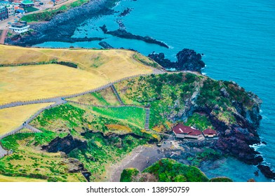 Black sand and seashore of Sunrise Peak, Jeju island, South Korea, one of the UNESCO nature tourism site in Korea.