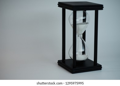 Black sandclock with white sand isolated on white background