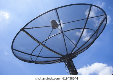 Black satellite dish against blue sky