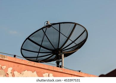 Black satellite on roof.