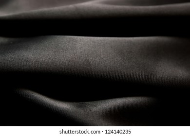 Black satin fabric close-up
