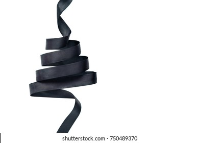 Black satin ribbon in shape of Xmas tree. Isolated on white background. Flatlay, copyspace for text