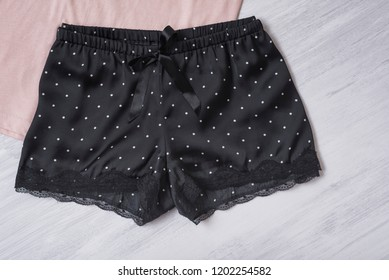 Black satin shorts with lace. Fashion concept