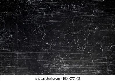 Black scraped metal sheet, grunge background or texture