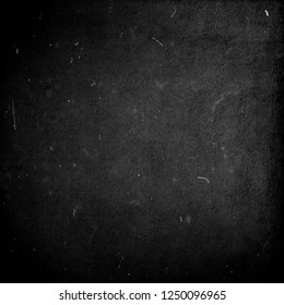 Black scratched grunge background, distressed texutre with frame, old film effect