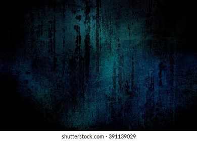 Black scratches on a dark blue-green wall. Grunge surface with cracks and scratches in the dark.