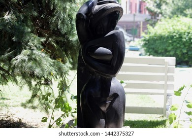 black sculpture seen in hattie cathan community garden bedford Stuyvesant section of Brooklyn on a sunny day in Brooklyn NY June 20 2019