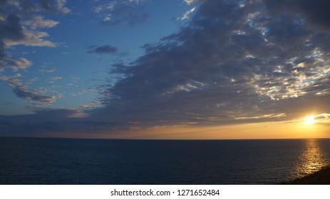 the black sea beach blue sky water sammer rock coast