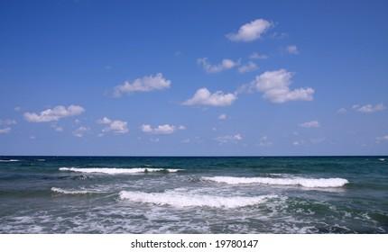 Black Sea, Bulgaria. Waves and white clouds.